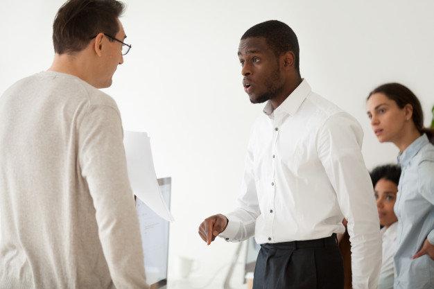 diverse-black-employee-white-boss-arguing-work_1163-5137