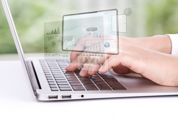 worker-looking-at-a-laptop-graphics_1232-1095