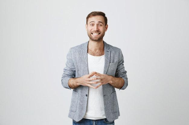 smiling-attractive-businessman-speaking_176420-17915